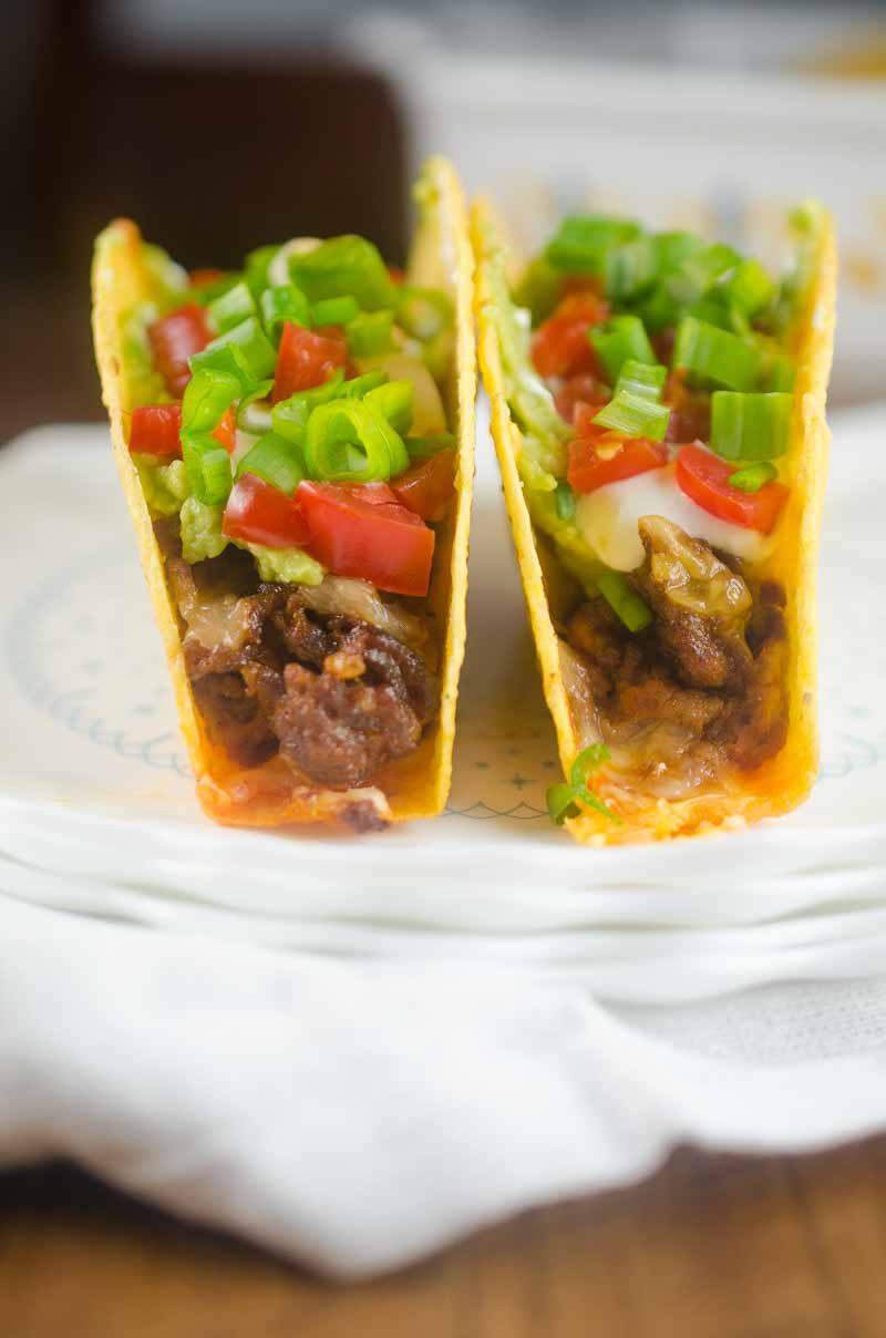 Everyone's favorite party dip turned into a taco! These 7 Layer Baked Chorizo Tacos will be a hit with the whole family!
