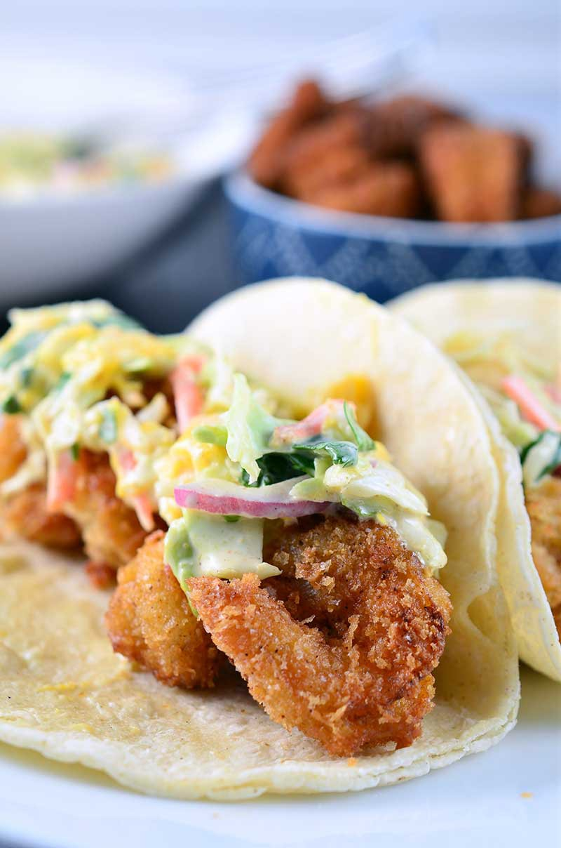 If you are looking for the fried crispy shrimp tacos these are it! These crispy shrimp tacos are loaded with crispy golden fried shrimp and a creamy mango slaw.