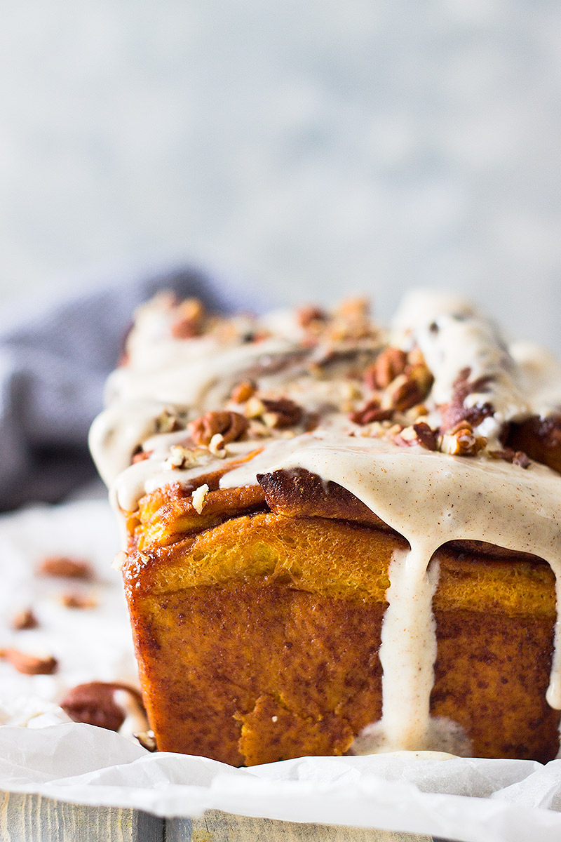 This Pumpkin Pull Apart Bread is a sweet pumpkin dough layered with cinnamon sugary goodness then topped with a pumpkin spice cream cheese frosting!!!