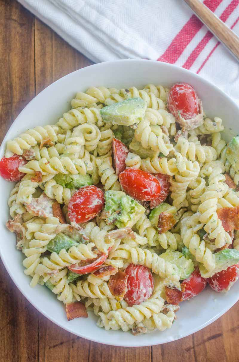 Make all the friends this summer with this Bacon Tomato Avocado Pasta Salad. It's a family favorite with crispy bacon, creamy avocado and sweet summer tomatoes.