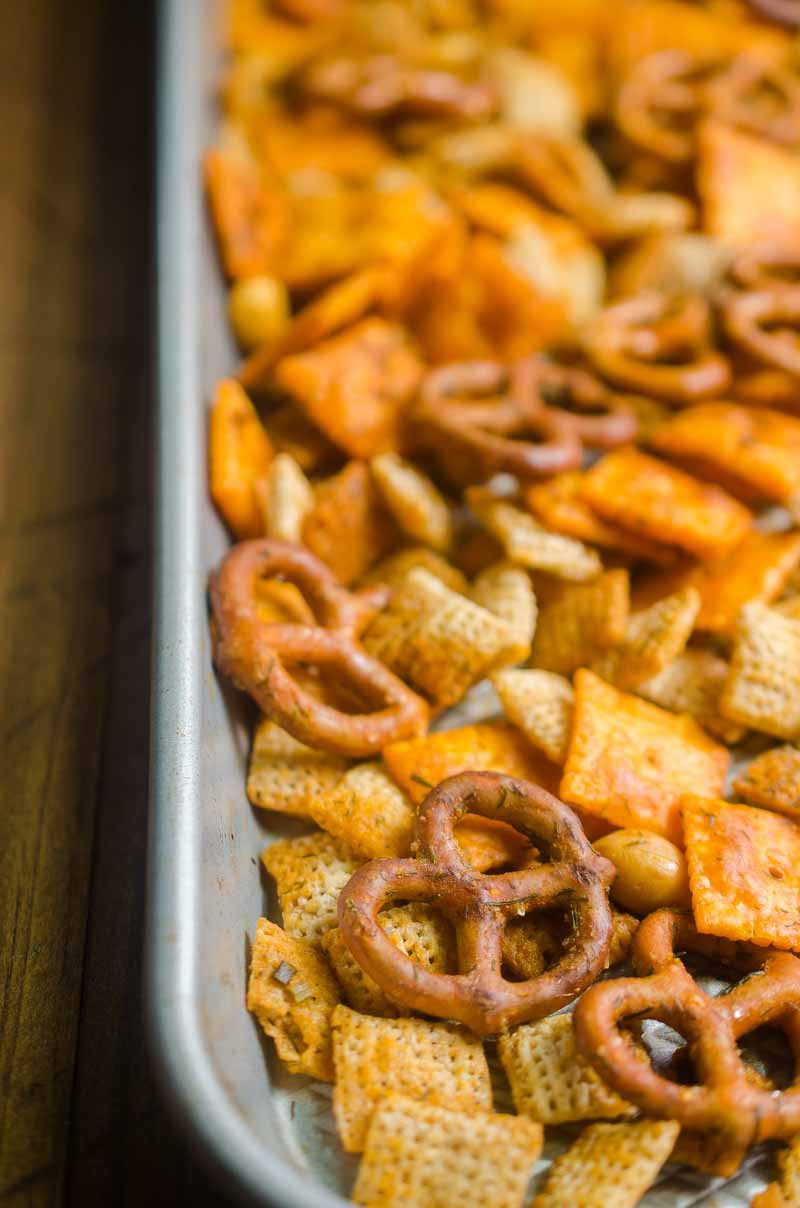 Buffalo Ranch Snack Mix is loaded with rice cereal, cheese crackers, pretzels and peanuts in a tangy buffalo ranch sauce.