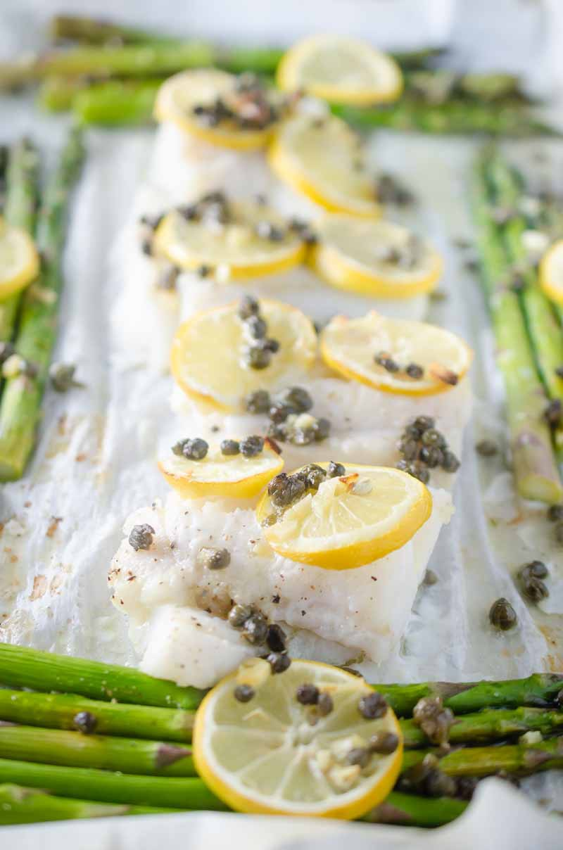 This Cod and Asparagus Sheet Pan Dinner topped with lemons and caper butter just screams easy spring meal!
