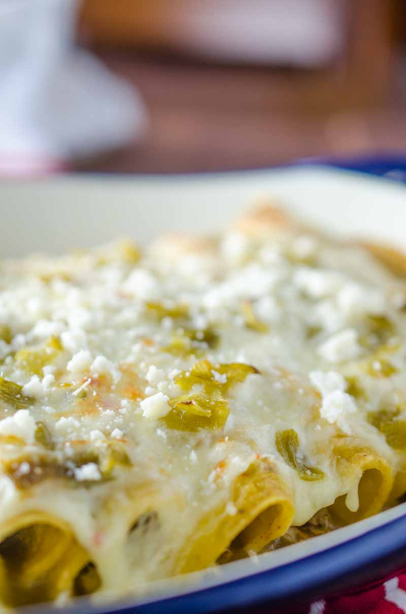 Green Chile Chicken Enchiladas are loaded with chicken, chiles and 3 kinds of cheese. They are perfect way to use leftover chicken.