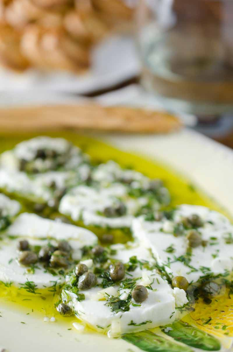 Tangy herb marinated goat cheese is the perfect appetizer to enjoy ...