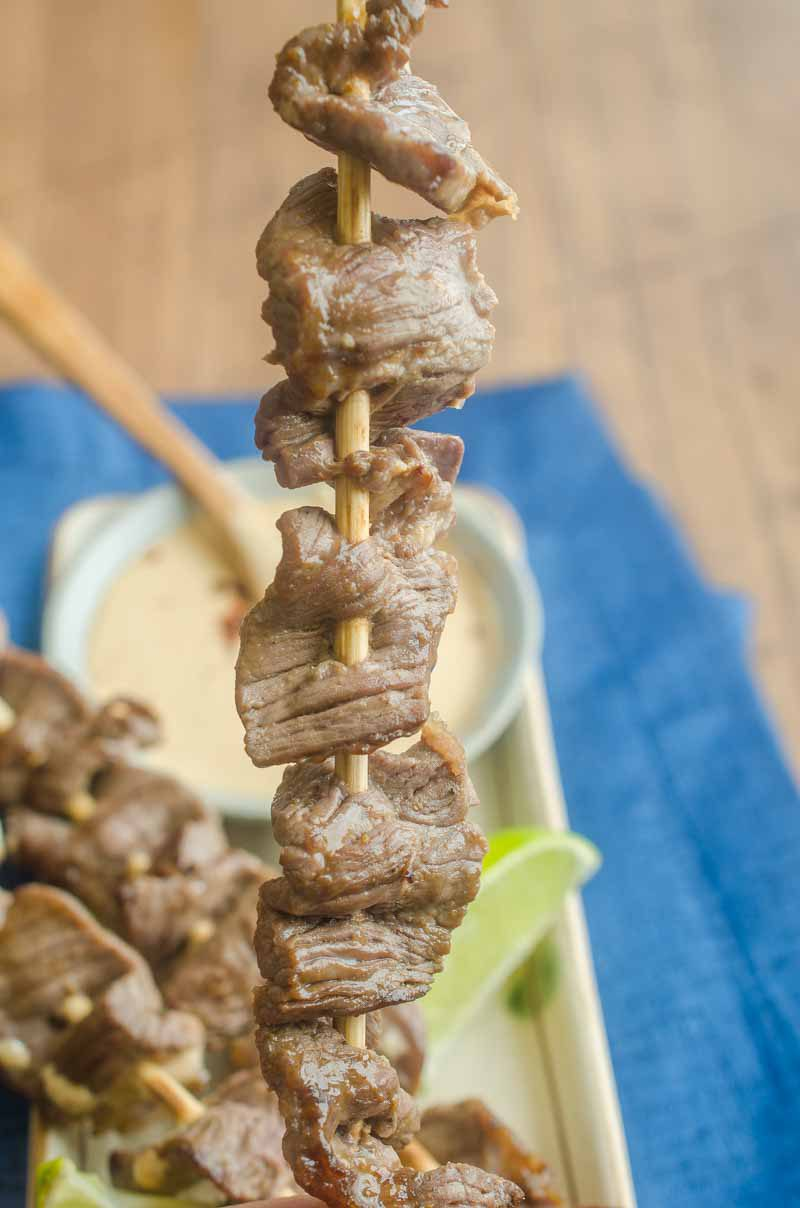 Hoisin Marinated Beef Skewers with Peanut Sauce are a family favorite. Sweet hoisin, tender beef and a creamy peanut sauce make them a flavor bomb!