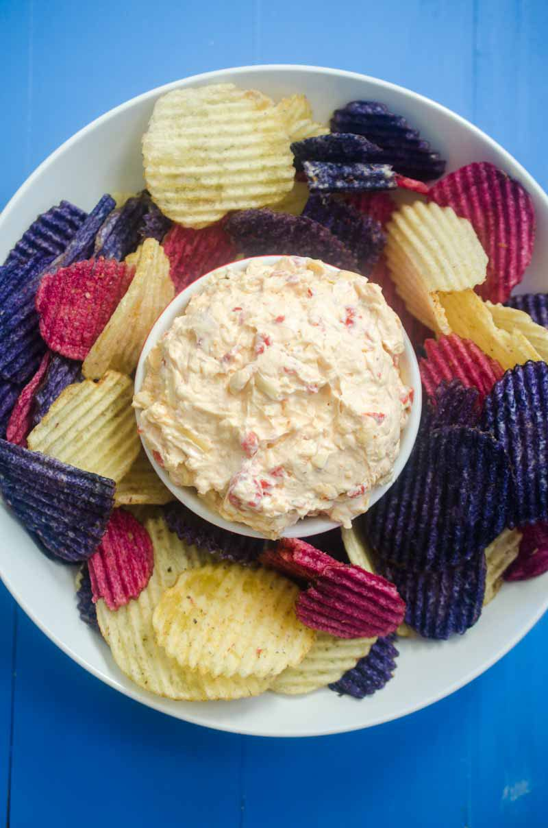 Classic Pimento Cheese gets dressed up with shredded gouda cheese. Spread it on crackers, make a grilled cheese or use it as a dip for chips.
