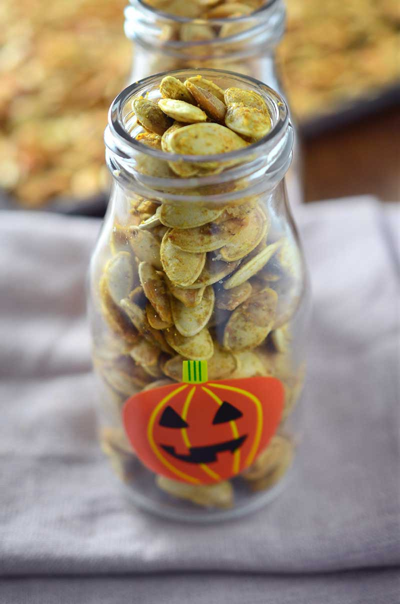 Roasted Pumpkin Seeds are a wonderful fall snack! Here are two different flavors to serve them: tossed in garlicky oil and butter and tossed in a spicy curry powder.