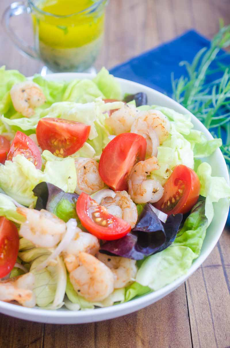 Tarragon Shrimp Salad is loaded with tender butter lettuce, shrimp, tomatoes and shallots tossed in a tarragon vinaigrette. It's a perfect summer lunch!