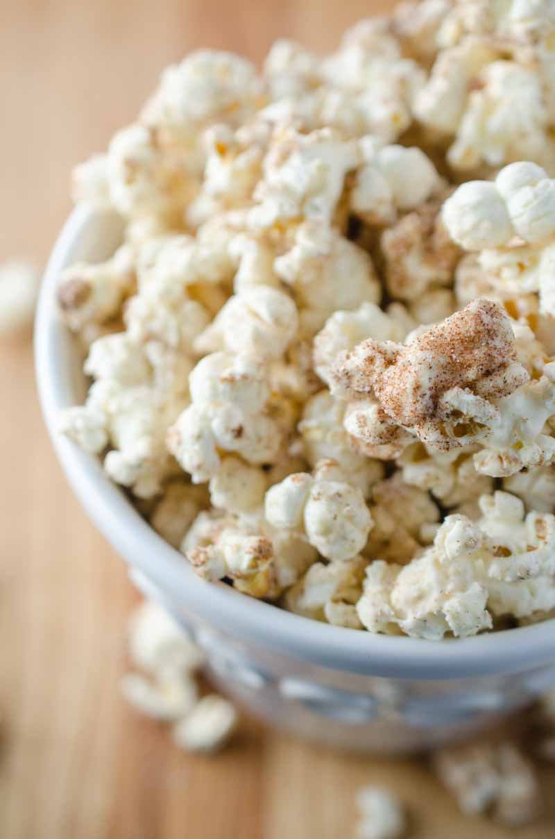 Everyone's favorite theme park treat gets turned into a popcorn snack with this churro popcorn loaded with cinnamon, sugar and white chocolate.