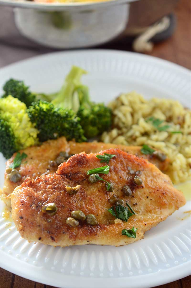 Tender chicken breasts dredged in flour, fried until golden and topped with a scrumptious butter caper sauce. This chicken is to die for.
