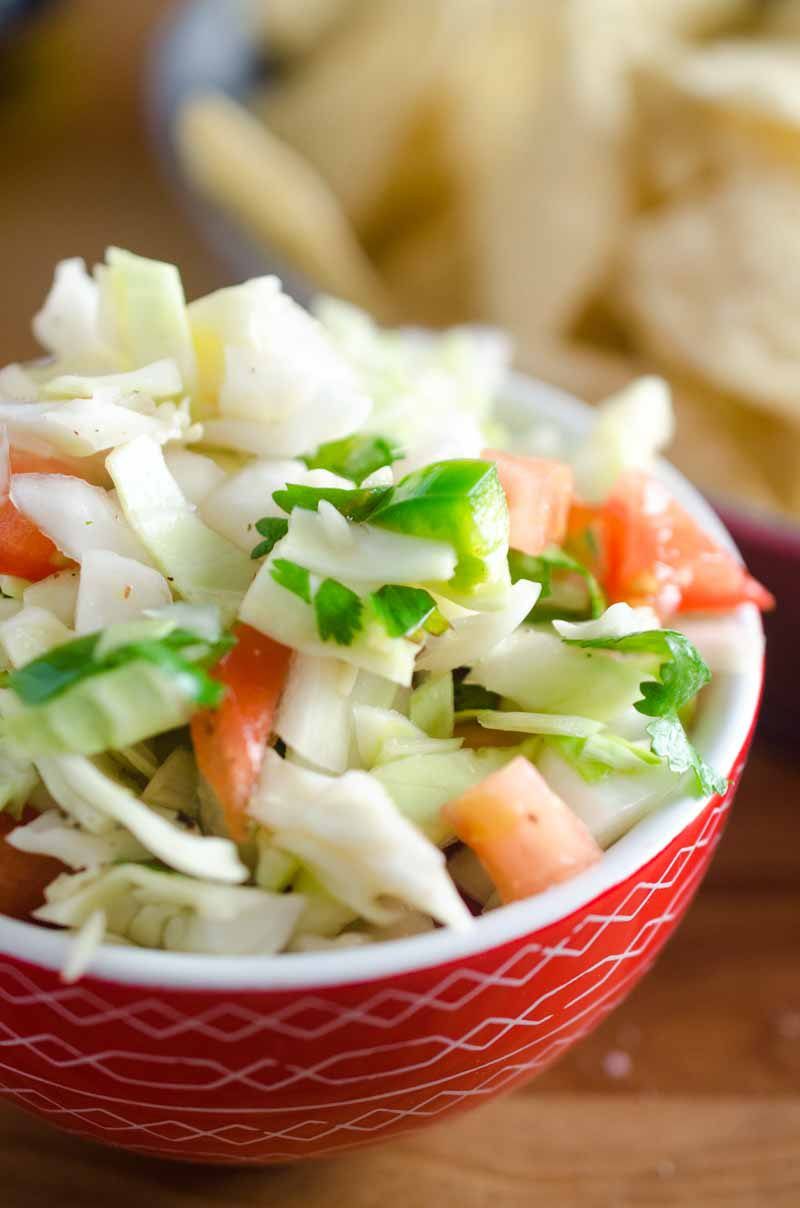 A crisp refreshing Cabbage Salsa with cabbage, onion, tomato, cilantro, jalapeno and lime.