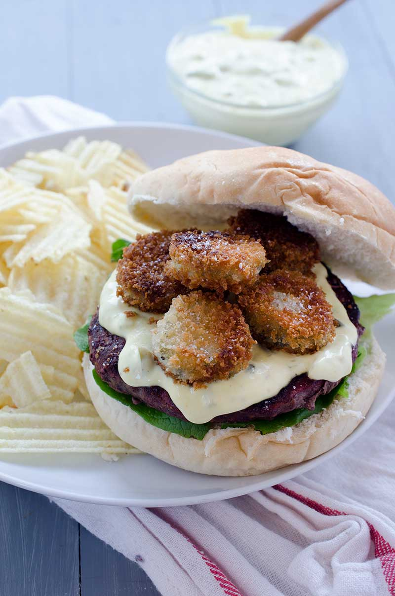 When it comes to epic burgers this Fried Pickle Burger loaded with spicy fried pickles and homemade burger spread is at the top of the list.