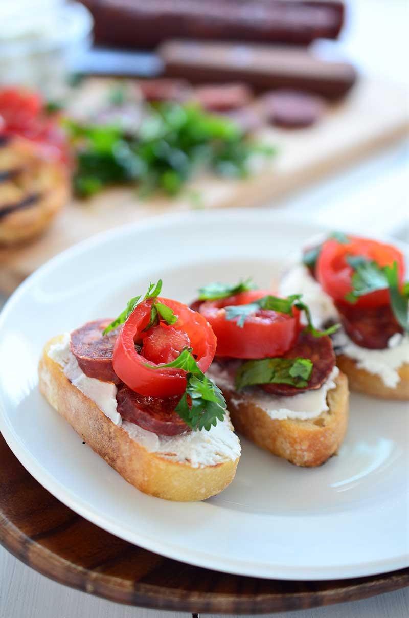 If you are looking for the perfect quick and easy appetizer for summer parties this Goat Cheese and Chorizo Crostini is it.