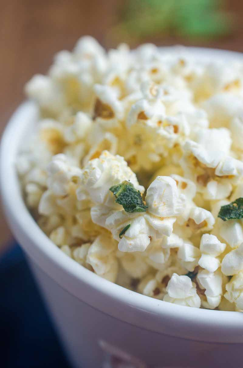 Want to jazz up everyone's favorite movie snack? Butter fried sage and thyme make this Herb Butter Popcorn perfect for movie night.