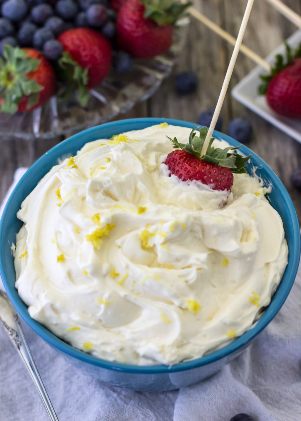 A little sweet and a little tart, this lemon cheesecake dip is the perfect accessory to your next party, cookout, or potluck!