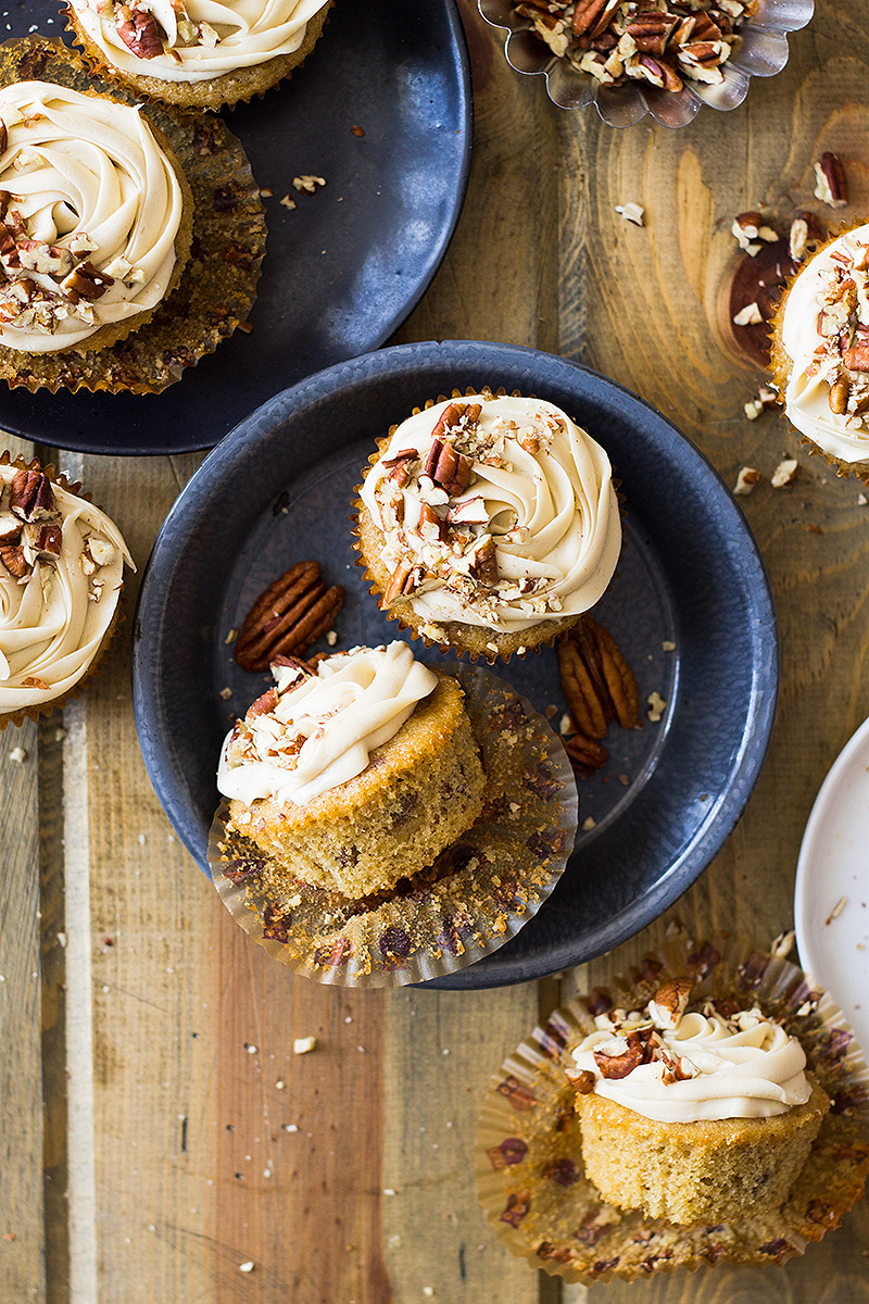 These Pecan Pie Cupcakes are light, fluffy, moist and studded with pecans. Then topped with a creamy pecan pie frosting!