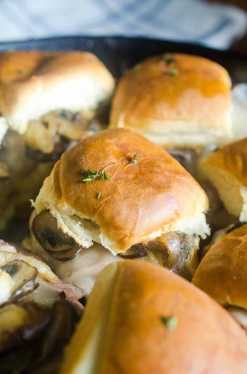 Quick and easy Roast Beef Mushroom Sliders are perfect for weeknights and game day! Loaded with roast beef, Swiss cheese, sautéed mushrooms and brushed with herb butter.