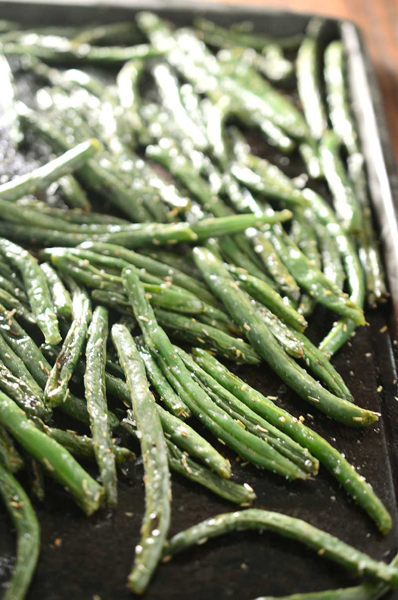 Rosemary roasted green beans are the perfect twist to a classic holiday meal side dish.