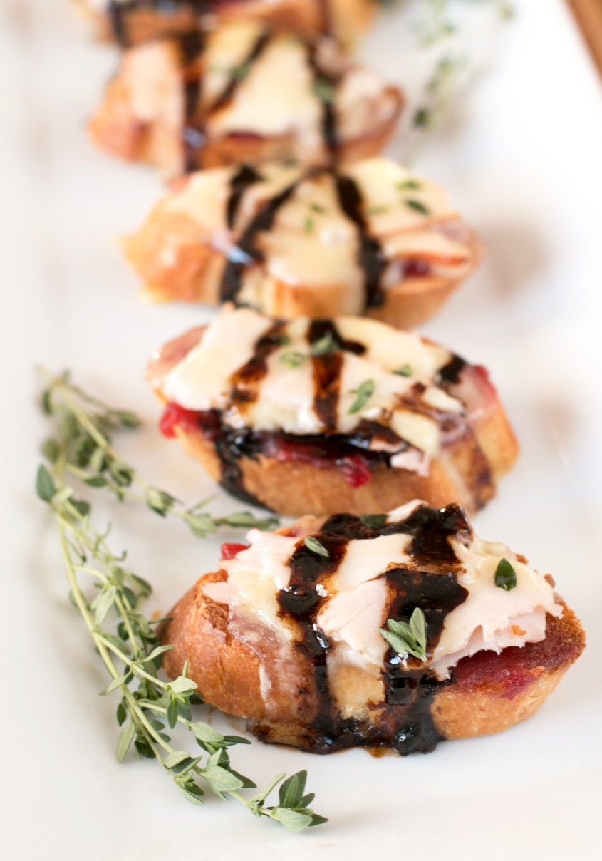 Turkey Brie Crostini. A combination of turkey and cranberry sauce to get you in the mood for Thanksgiving dinner, plus a hefty dose of melted, gooey brie.