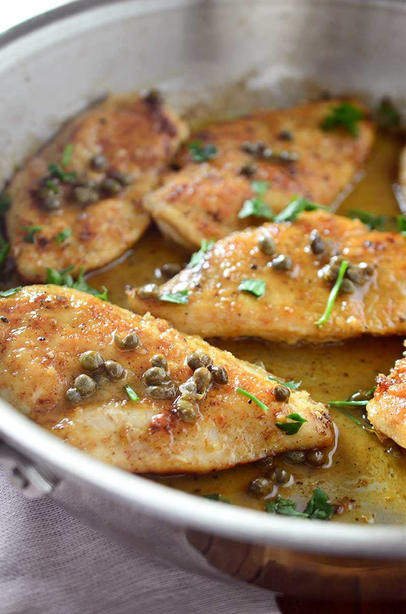 Tender chicken breasts dredged in flour, fried until golden and topped with a scrumptious butter caper sauce. This Chicken Piccata recipe is to die for.