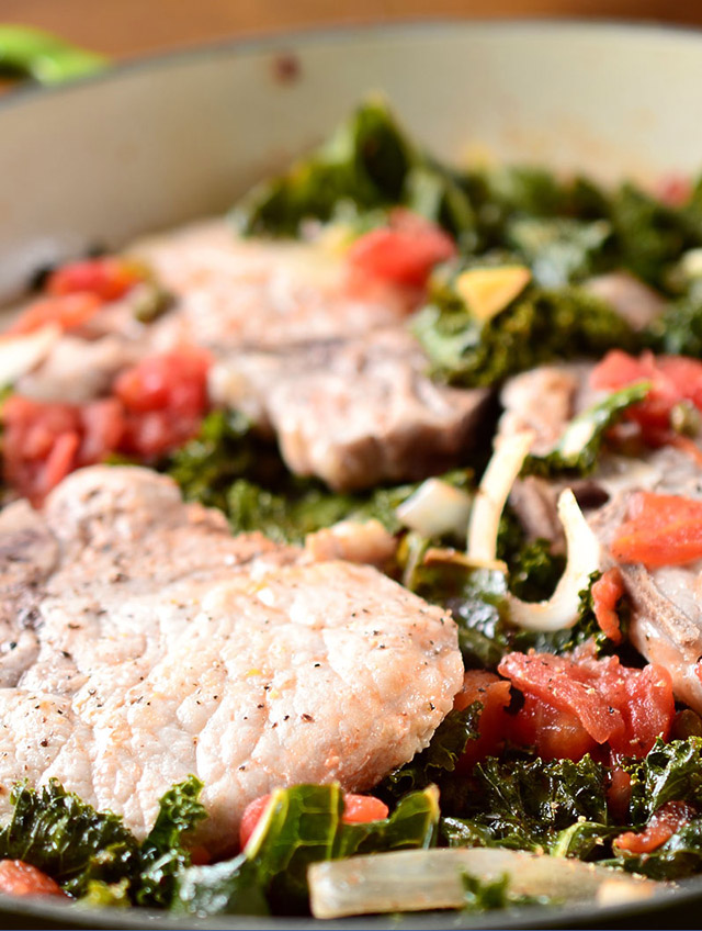 Braised Pork Chops with Kale and Tomatoes