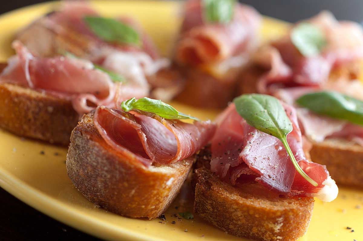 Prosciutto and Basil Crostini
