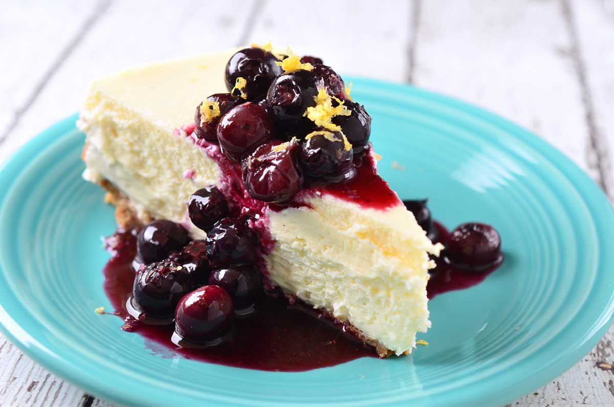 Vanilla Bean Cheesecake with Blueberry Lemon Sauce