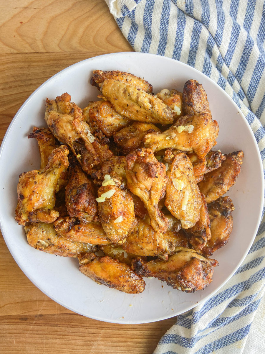 Overhead photo of air fryer chicken wings in a white bowl.