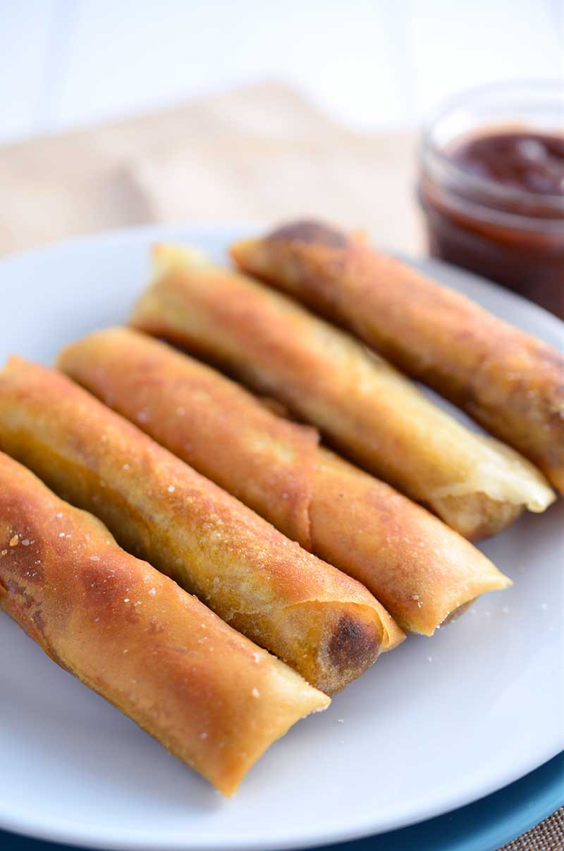 BBQ Pulled Pork Egg Rolls are loaded with slow cooker pulled pork, bbq sauce, red onions and jalapeños then fried until golden. Egg. Roll. Perfection.