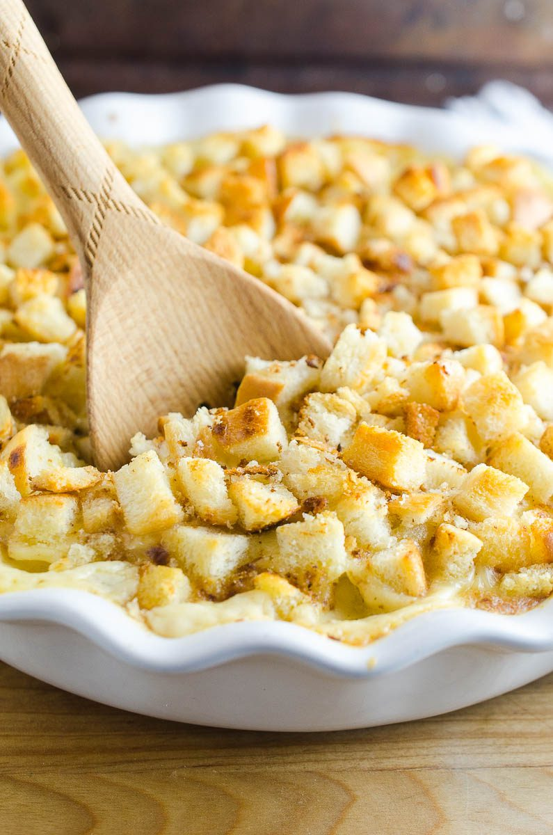 Oven Baked Macaroni And Cheese is a classic comfort food side dish. This easy mac n' cheese recipe is creamy and cheesy, topped with bread crumbs and baked.