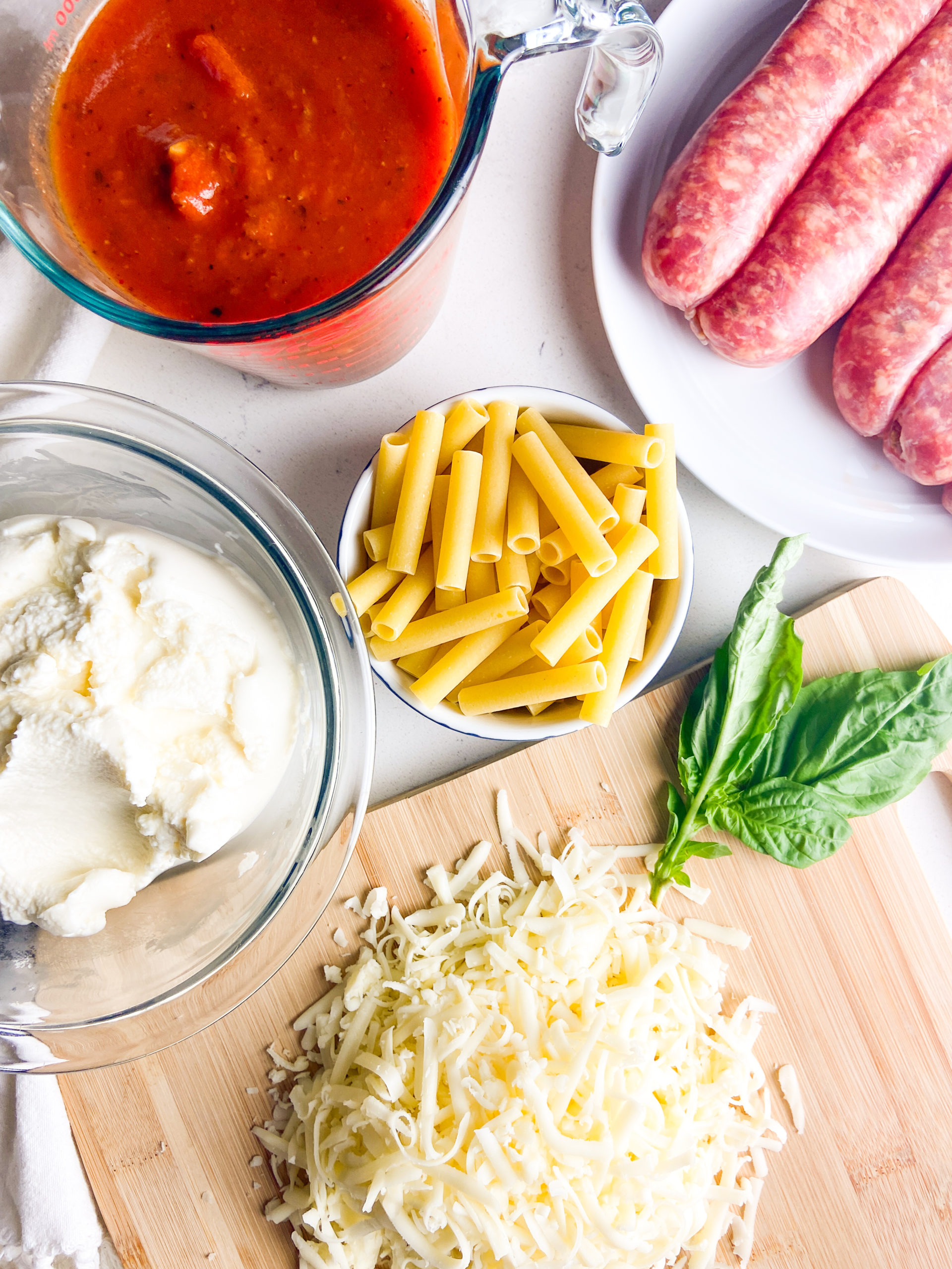 Ingredients for baked ziti with italian sausage.