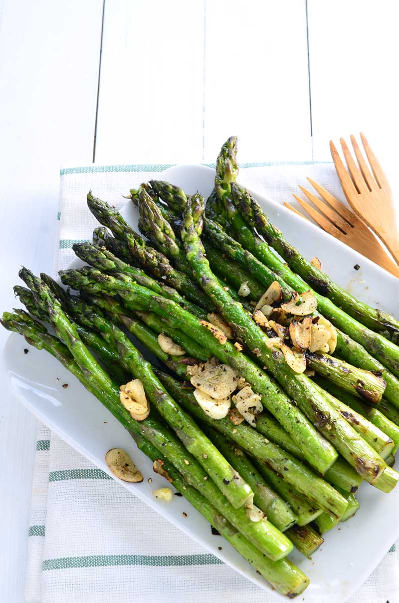 Simple Blistered Asparagus calls for 5 ingredients and is ready in less than 10 minutes. Spring side dish perfection. Gluten free and vegan!