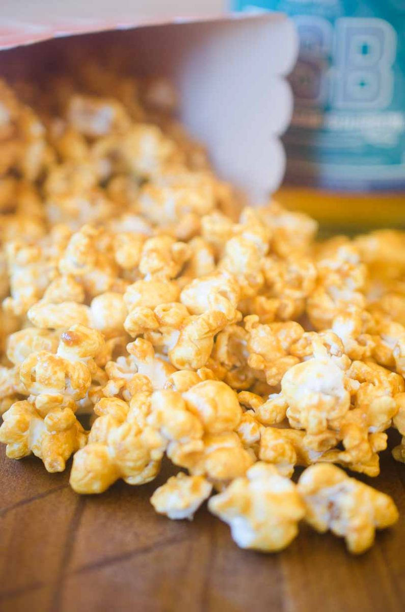 Bourbon Caramel Corn is THE snack you need to have for all of your baseball watching this summer. Popcorn coated in a sweet caramel made with Brown Sugar Bourbon is an addicting snack!