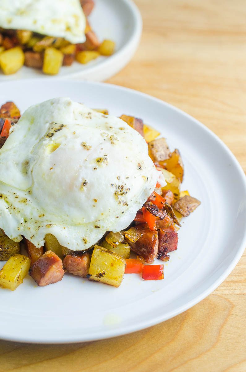 Cajun Breakfast Skillet is loaded with potatoes, andouille sausage, onions, bell peppers and cajun seasoning. Then topped with a perfectly fried egg. It's an easy, hearty way to start your day!