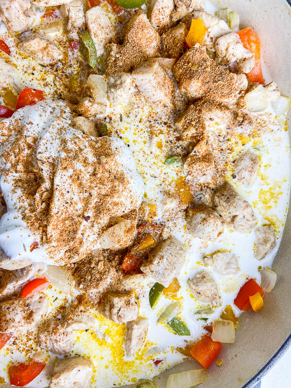 Photo of rasta pasta with sour cream, half and half, chicken and bell peppers.
