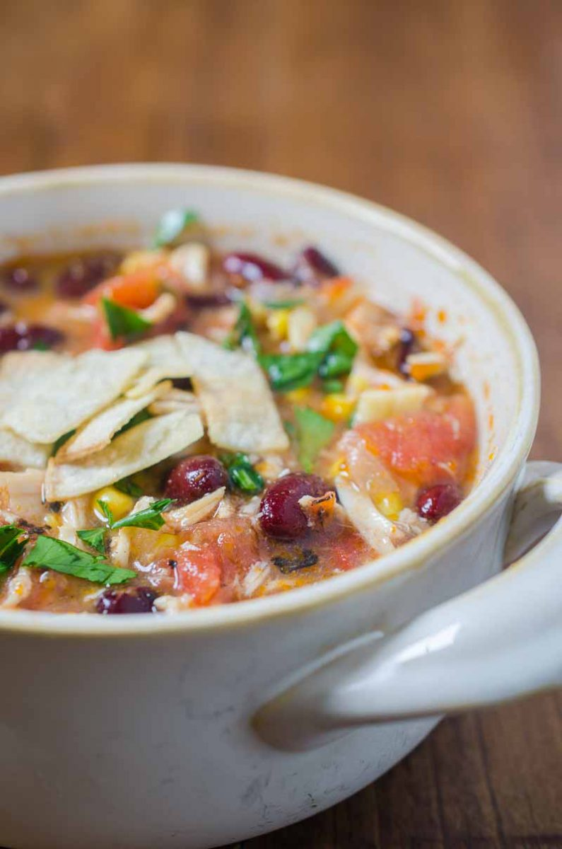 Chicken Tortilla Soup is a classic for a reason. This soup is loaded with tender chicken, beans, corn and fire roasted tomatoes. Sure to warm you up on a cold winter's day!