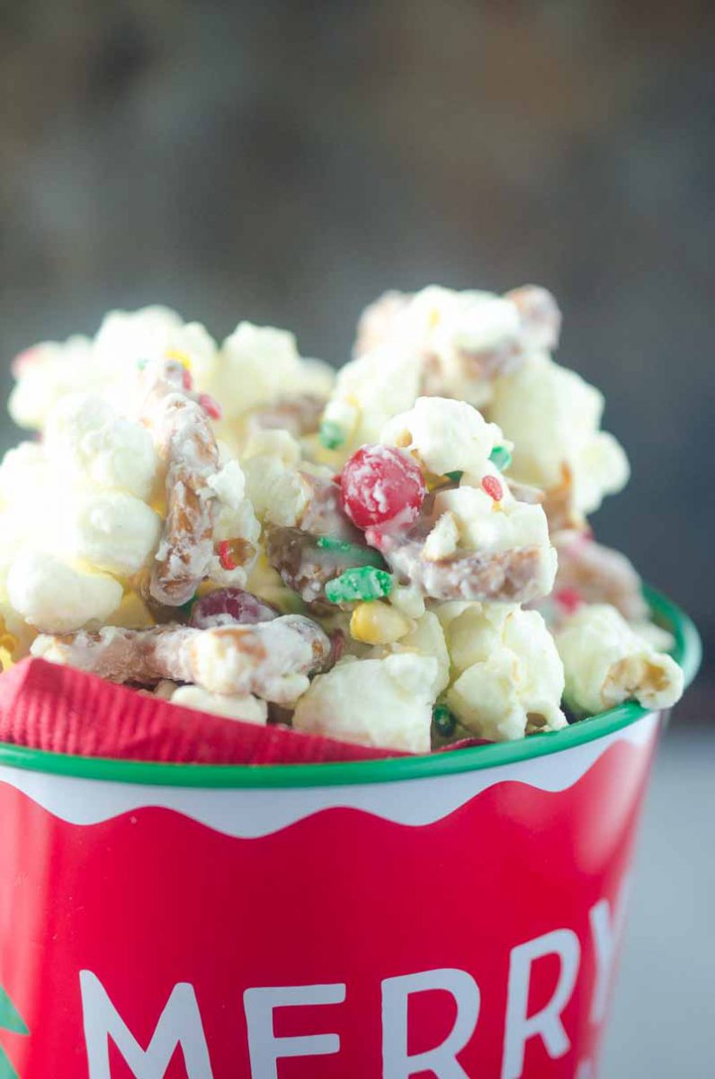 Cinnamon Christmas Popcorn with white chocolate, cinnamon candies and sprinkles will be your new favorite holiday treat. It takes about 10 minutes to prepare and makes a perfect gift too!