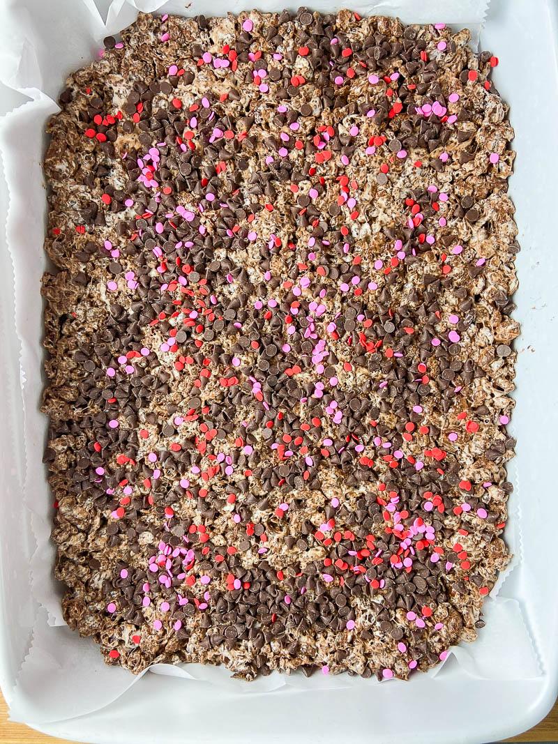 Overhead photo of cocoa pebble krispie treats in a pan.