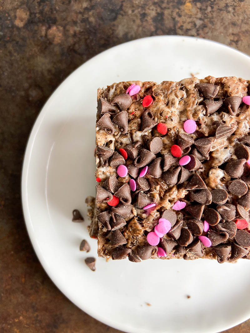 Cocoa Pebble Treats on a white plate.