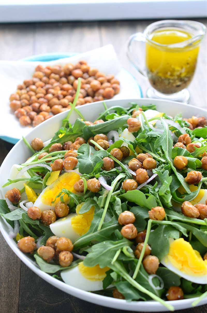 This crispy chickpea and arugula salad is loaded with arugula, crispy fried chickpeas, boiled eggs, shallots and then drizzled with a mustard vinaigrette.