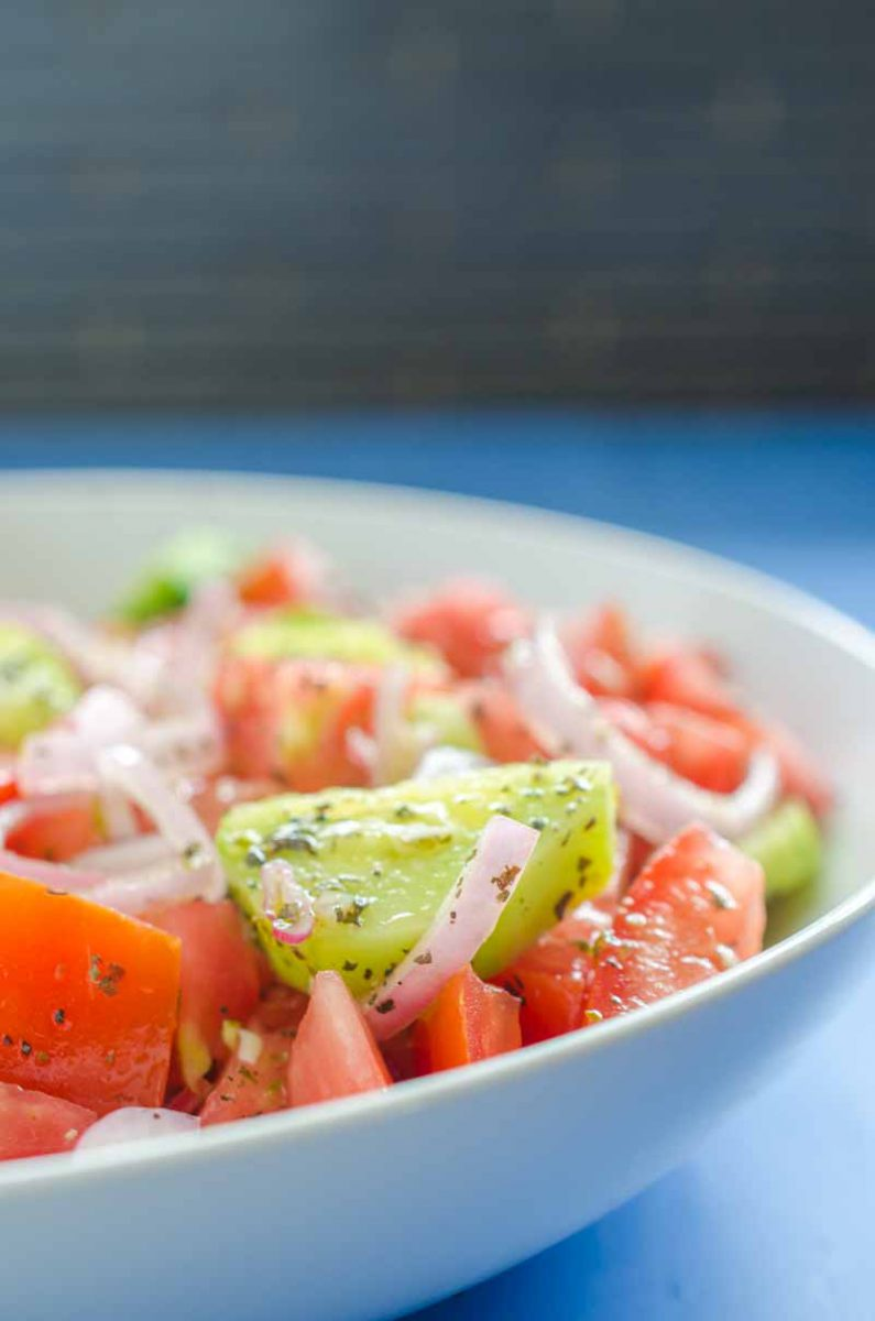 Cucumber Tomato Salad is my absolute favorite summer salad. Fresh cucumbers, summer tomatoes, shallots and a quick vinaigrette make this perfect for all of your summer cookouts.