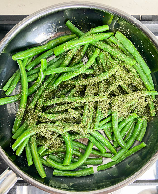 Green beans in a skillet with butter and dill.