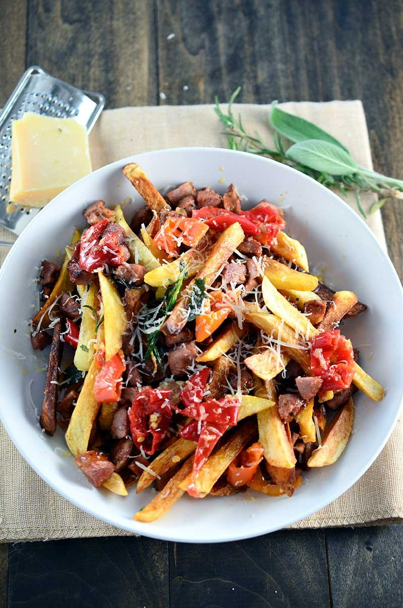 Dirty Fries are loaded with andouille sausage, mama lil's peppers, fried herbs and parmesan. Go ahead treat yourself.