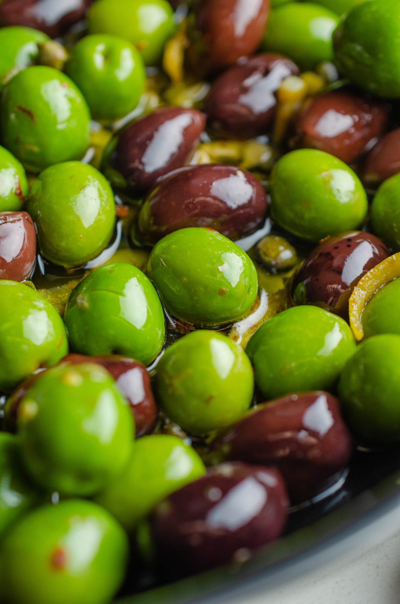 Cooking olives in oil in a pan.