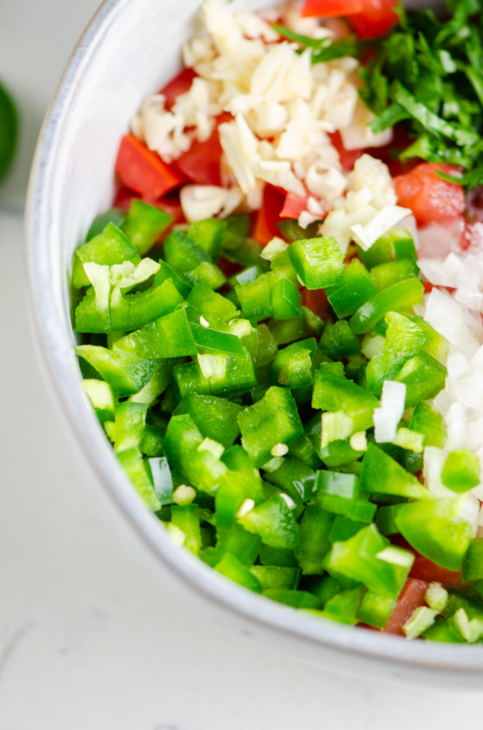 Side close up photo of diced jalapenos.