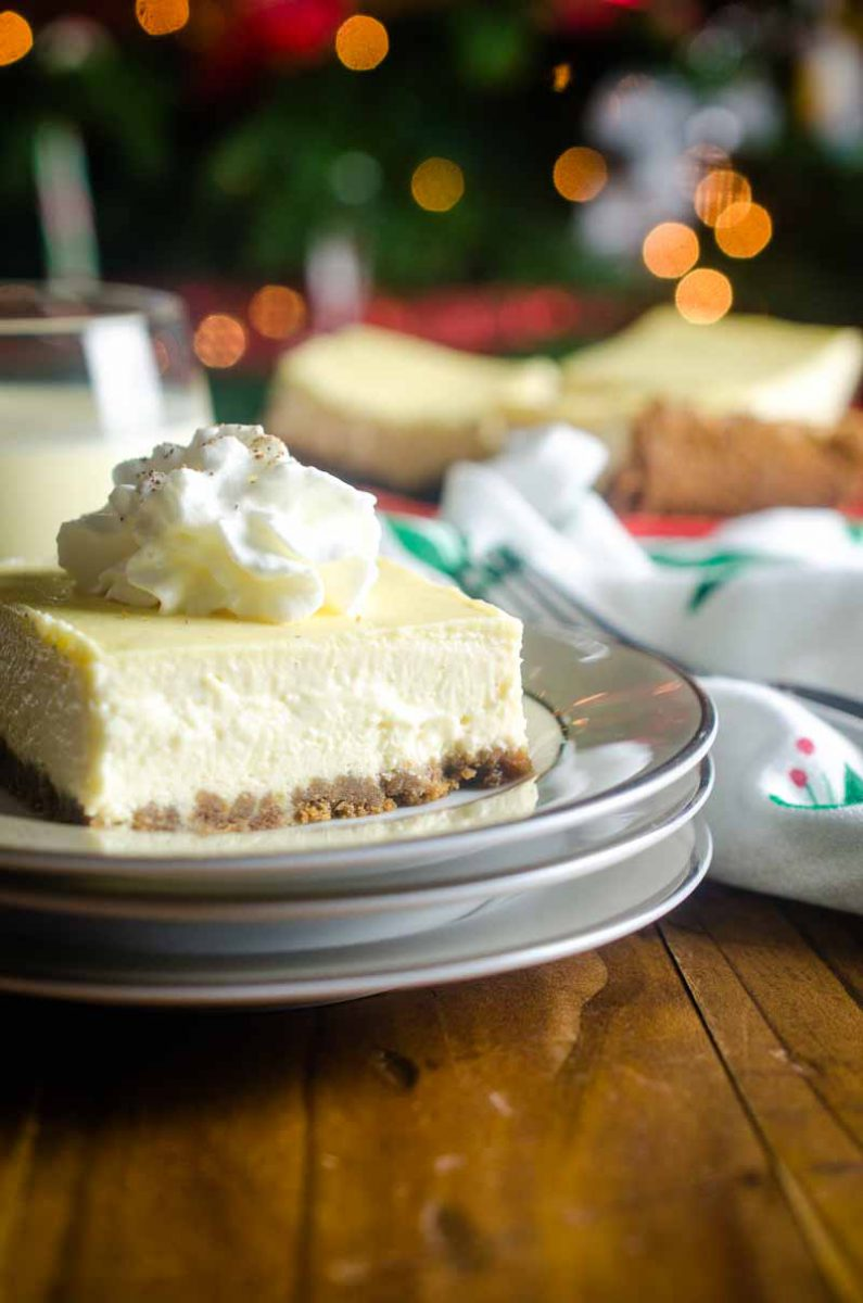 Eggnog Cheesecake Bars are the perfect dessert for holiday get togethers! Gingersnap crust and smooth eggnog cheesecake make them irresistible.