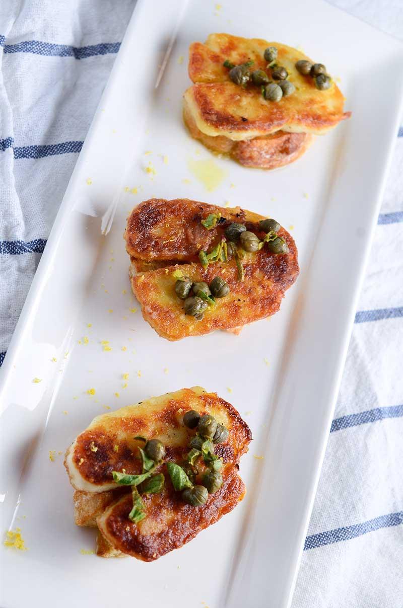 Fried Halloumi Crostini with Lemon Caper Oil