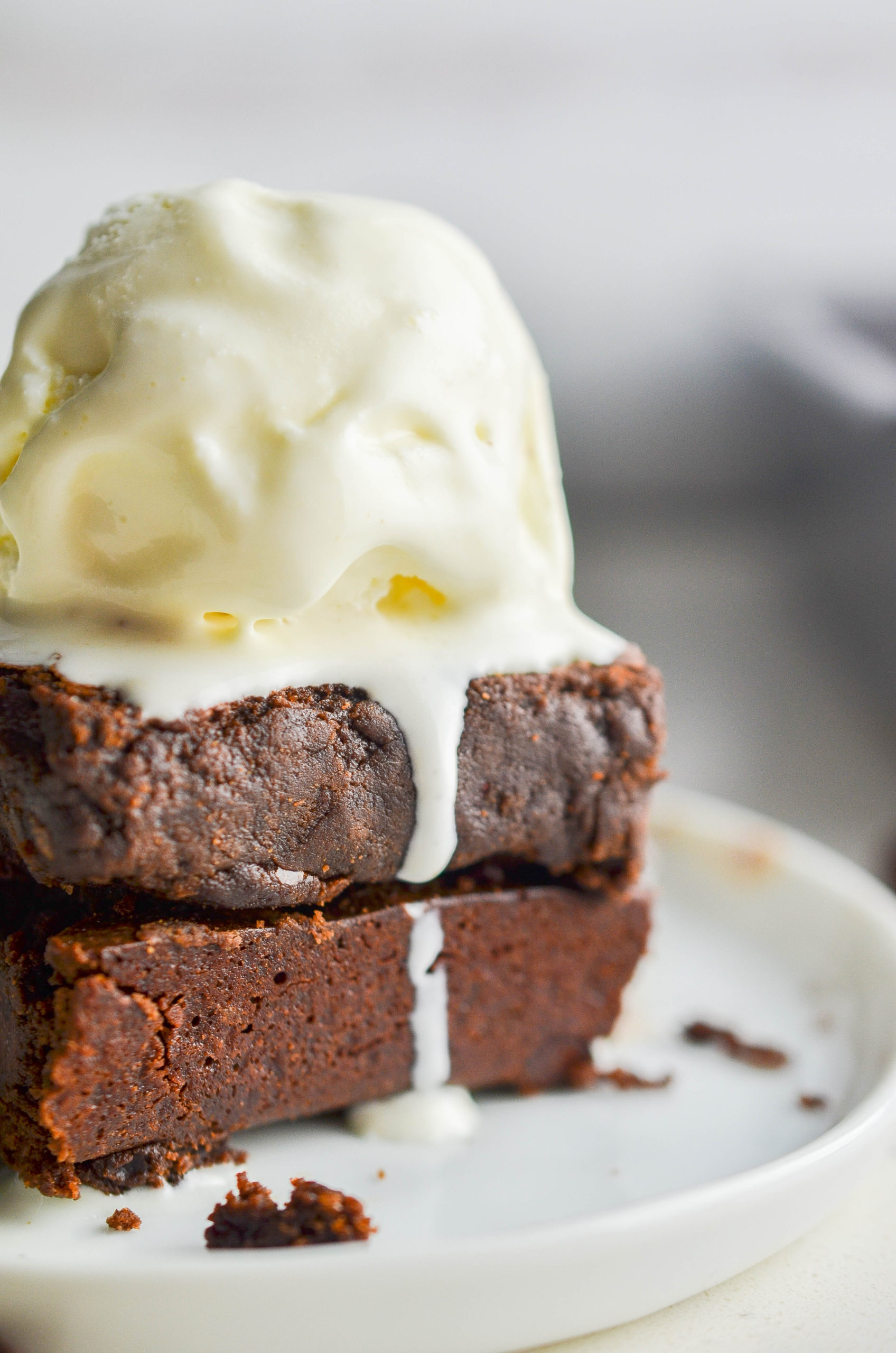 Brownies with ice cream on top.