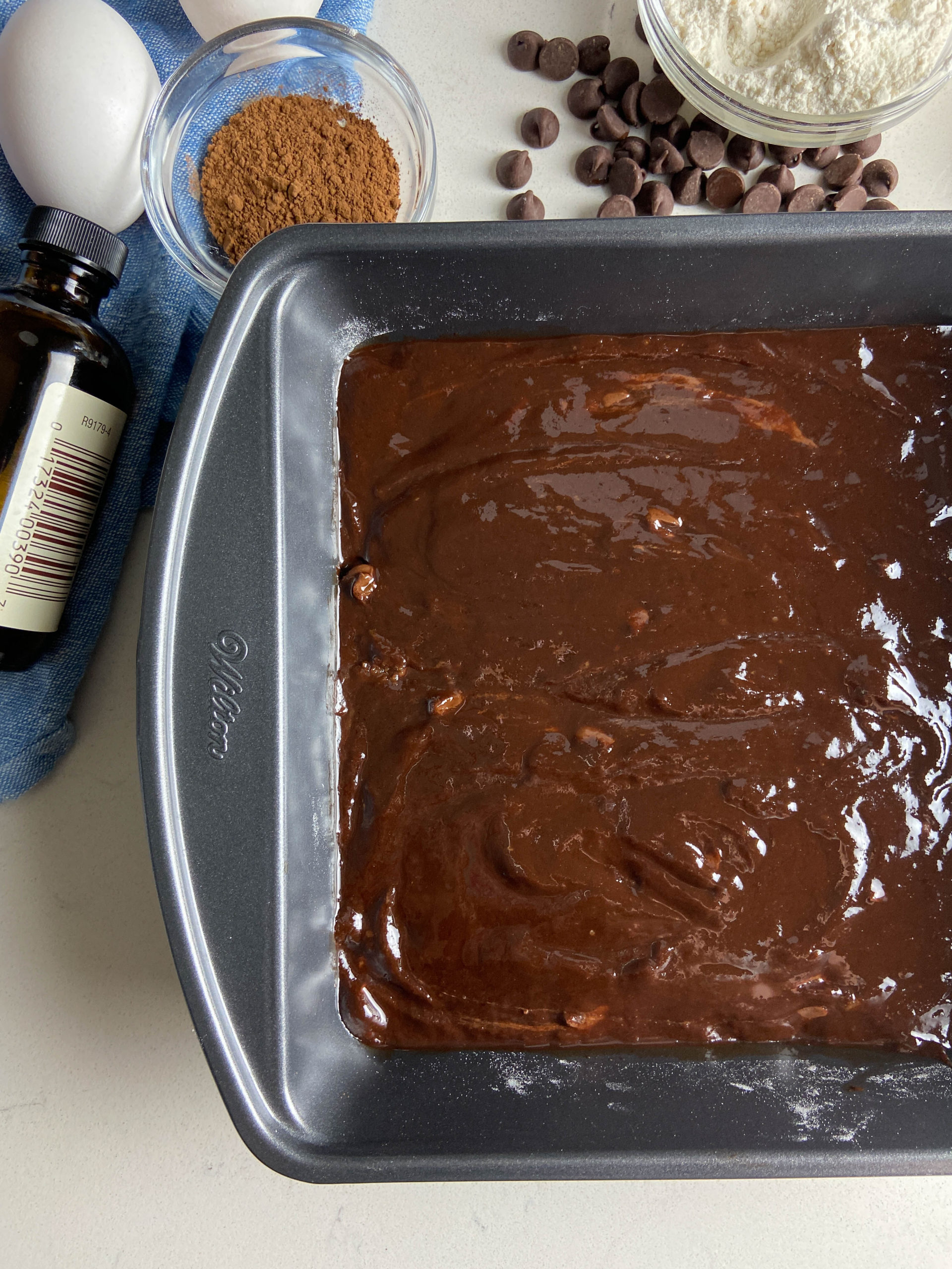 Raw brownie batter in a baking dish.