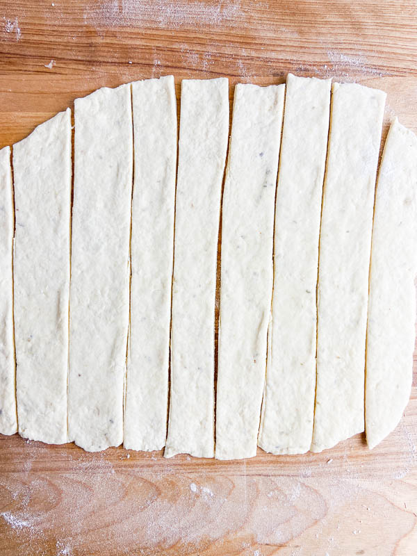 Breadstick dough cut into strips.